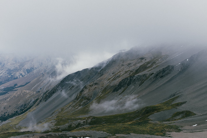 The alpine environment with the top half obscured by cloud
